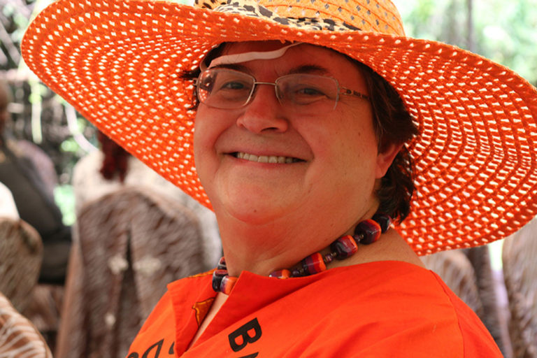 Dr. Jan Low dons an orange hat at an OFSP event. Biofortified orange-fleshed sweetpotato is a powerful tool in the fight to counteract rampant vitamin A deficiency. CIP Staff